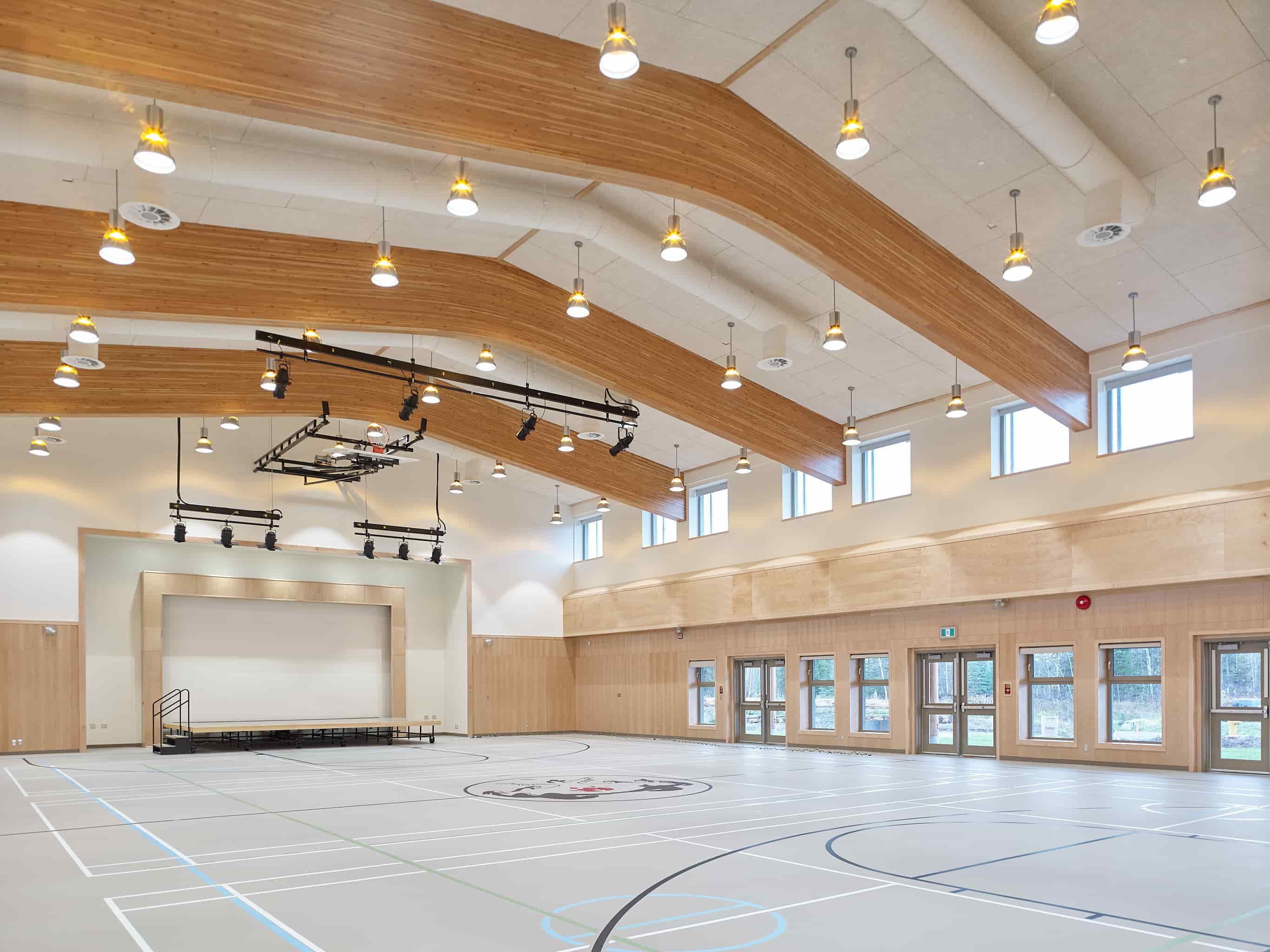 gym with timber beams, t-bar ceilings