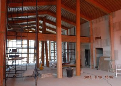 large room with timber framing and unfinished drywall