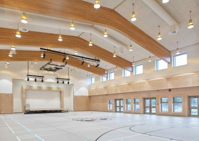 gym with timber framed beams and t-bar ceiling